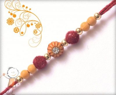 Online #Rakhi #Shopping 2015:- Buy Rakhi, Velvet Rakhi Delivery In #India #USA #UK #Australia #Canada #Dubai #Singapore #NZ Delicate Diamond with Velvet Beads Rakhi, surprise your loved ones with roli chawal, chocolates and a greeting card as it is also a part of our package and that too without any extra charges.  http://www.bablarakhi.com/send-designer-rakhi-online/1134-send-delicate-diamond-with-velvet-beads-rakhi-online.html