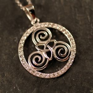 Our Triskele Trinity Necklace glimmers with brilliance. The Triskele or triple spiral design is the Celtic symbol for the three stages of woman; maid, mother and wise woman. Where are you on the spiral of life?