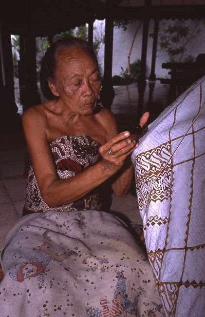 In Yogjakarta, Indonesia, batik production is famous. In this photo, a skilled artist demonstrates batik writing.
