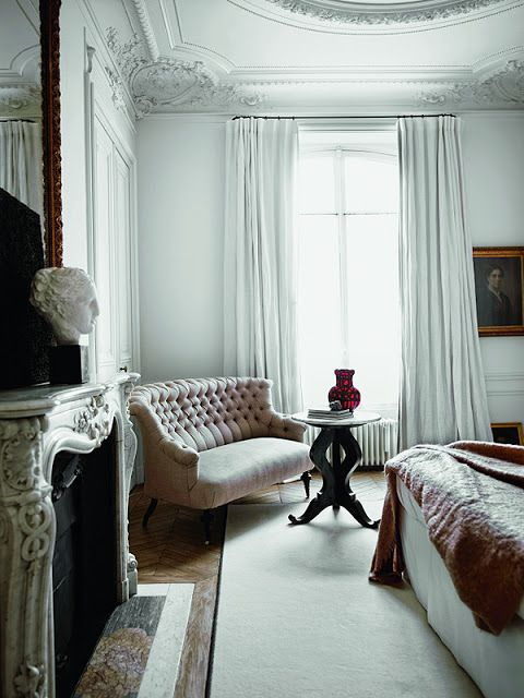 Paris apartment -- the molding, the couch, the fireplace, high ceilings, serene white..... I could go on & on!