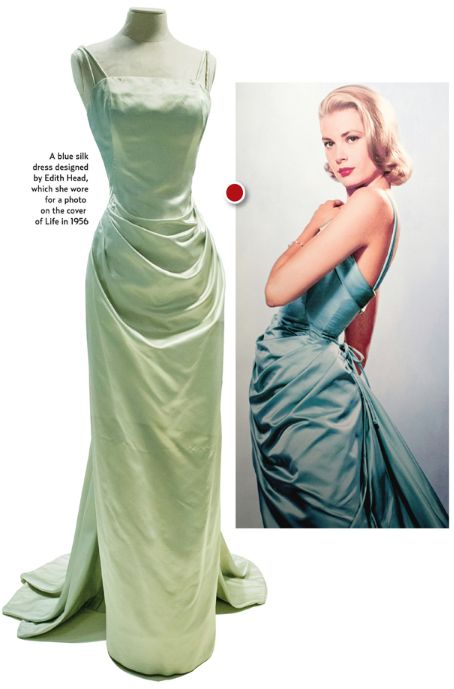 """Visitors to the exhibition are greeted by the photo that adorned a LIFE cover in 1956; Grace Kelly wearing a seafoam /blue gown designed by Edith Head. On display is the dress and the matching coat.  """"She wore things that she liked many times,"""" curator Cynthia Cooper said, noting she also wore the dress to the opening of The Country Girl, for which she won an Oscar in 1955."""