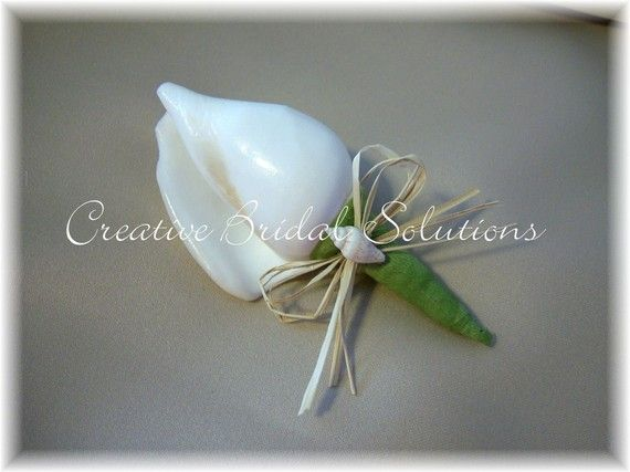 Canarium Shell Boutonnieres by CreativeBridal on Etsy, $12.00