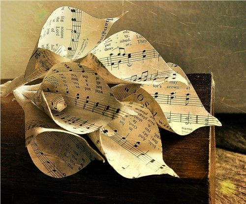 Two Dozens Calla Lilies Made of Vintage Music Sheets  Sorry that this isn't a site with instructions but rather a store... I could figure it out would be so pretty for future recitlas