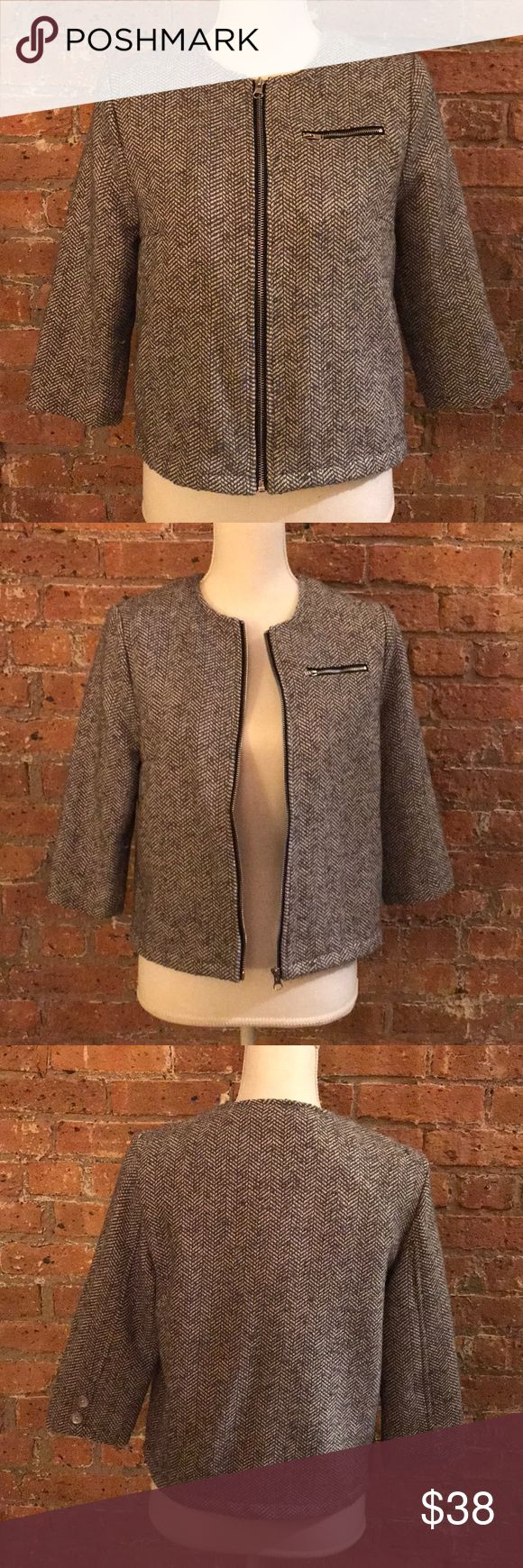 Gorgeous zip up knit blazer This black and white knit zip up blazer is the perfect addition to your work attire. Silver zip pocket on the left breast with polyester inside. Jackets & Coats Blazers
