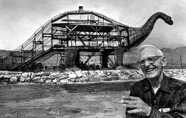March 23, 1970: Sculptor Claude K. Bell with his 45-foot- tall, 150-foot-long brontosaur in Cabazon next to Interstate 10.: Bell, a Knott's Berry Farm sculptor and portrait artist, opened the Wheel Inn cafe in 1958 and began building dinosaurs to attract customers. by Scott Harrison, latimes. Photo by John Malmin/latimes #Dinosaur Claude_K_Bell #Scott_Harrison #John_Malmin #latimes: Building, Claud Belle, The Angel, Cabazon Dinosaurs, Wheels, Under Construction, Palms Spring, Roadsid Attraction, Berries