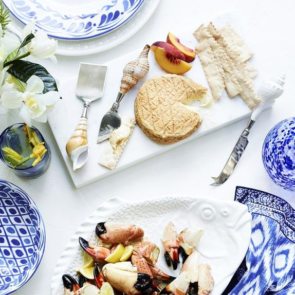 Cheese board for a summery touch seashell knife spreaders.