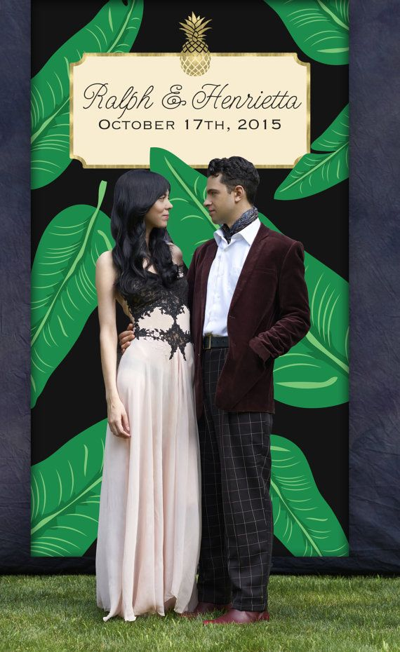 This tropical wedding photo backdrop measures 4 x 7, is made of vinyl, and makes awesome wedding reception decor for a photo booth. This backdrop features hand illustrated palm fronds with a black background and a gold pineapple. We customize the backdrop with your names and date, and you get to select the fonts. This is part of a set of wedding pieces you can see the collection here…