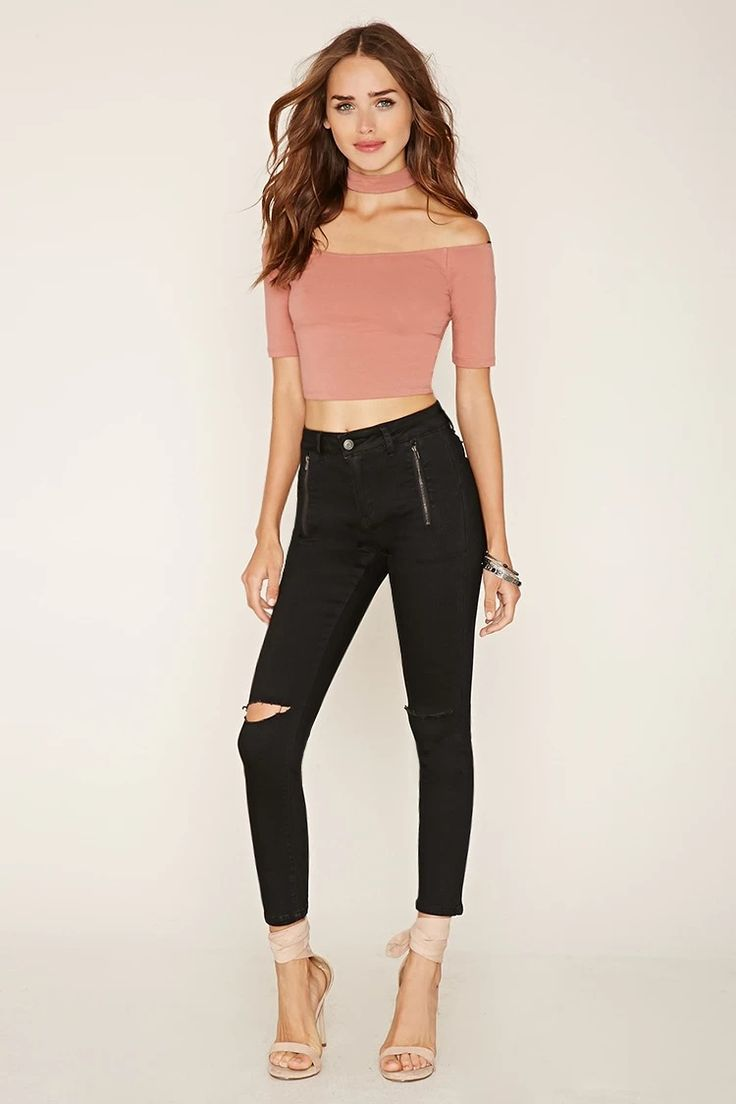 A pair of skinny jeans with ripped knees, a zip fly, back patch pockets, vertical zippered front pockets, and mock zippered back pockets. #f21denim