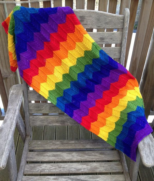 Free Knitting Pattern for Rainbow Hills Blanket - Easy zigzag stripe blanket in 4 sizes. Western Hills Blanket designed by Julia Stanfield. Pictured project by mrsbielawski