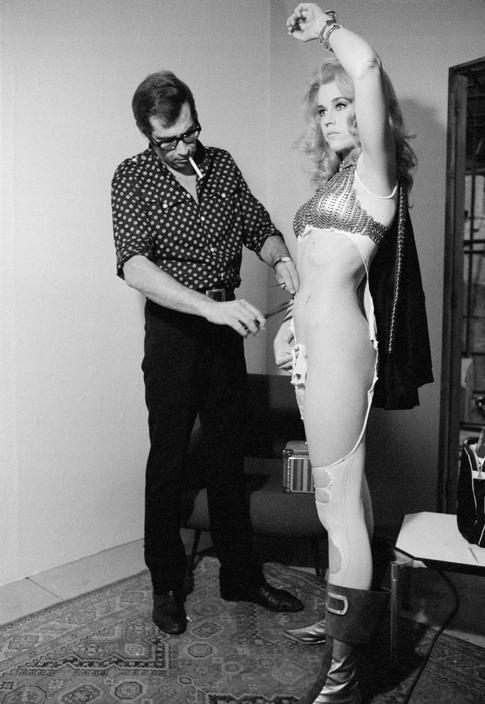 Roger Vadim makes alterations to Jane's Barbarella costume, Rome, 1967