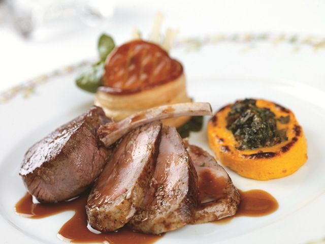 Duo of seasonal game with a Swiss chard vol-au-vent, parcel of wild mushrooms and spinach, poivrade sauce
