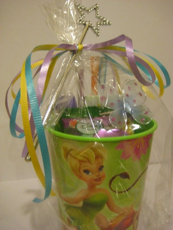 party favors - Tinkerbelle cup full of candy, all in cellophane bag, tied a fairy's wand with curly ribbons. So cute!
