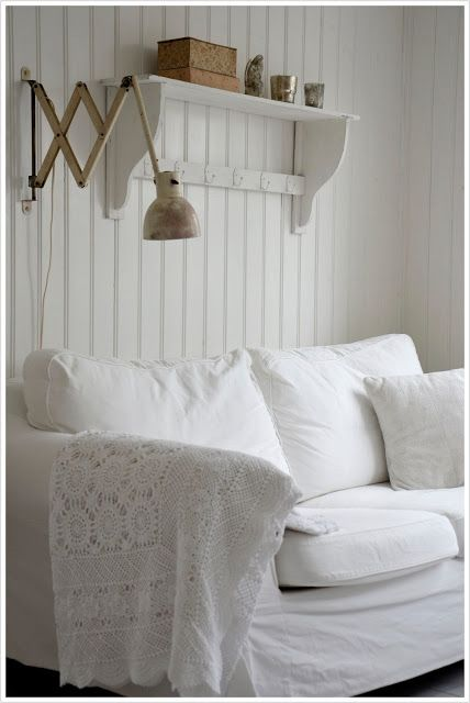 White slipcovered sofa