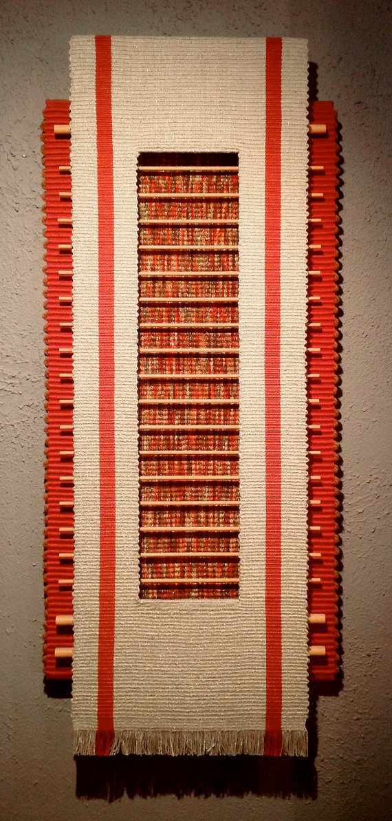 Entitled Sun Ladder this fiber sculpture is a study in depth, dimension, structure, and texture, presented in a pleasing sun-warm palette.. $1 850,00, via Etsy.