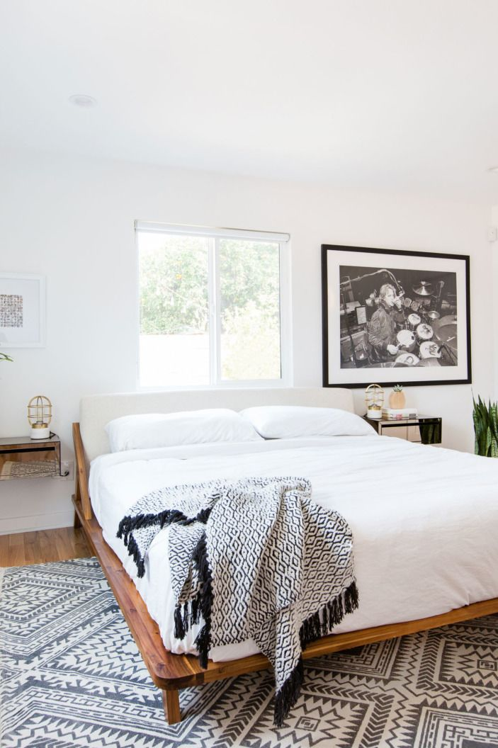 After the floors were changed, the bedroom was pretty set to go. For the minimalist furnishings (both the bed and the floating nightstands), the couple went to CB2.