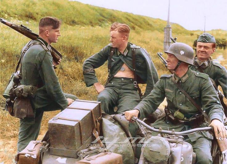 A wounded Panzer Grenadier Großdeutschland Division NCO getting a ride in a BMW R75 motorbike sidecar is talking to a soldier carrying a Mauser K98 sniper rifle during the Kursk Offensive in the summer of 1943. Pin by Paolo Marzioli