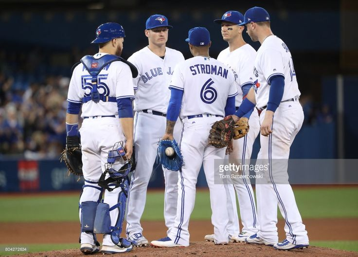 Marcus Stroman #31 of the Toronto Blue Jays is joined on the mound by Russell Martin #55 and Josh Donaldson #20 and Troy Tulowitzki #2 and Justin Smoak #14 moments before being relieved in the eighth inning during MLB game action against the Baltimore Orioles at Rogers Centre on June 28, 2017 in Toronto, Canada.