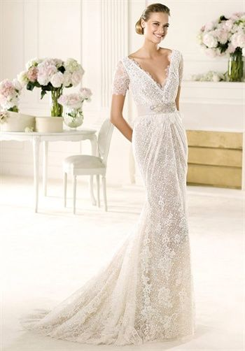 Flared guipure lace V-neck wedding dress with lace sleeves | Vergel from Manuel Mota for Pronovias