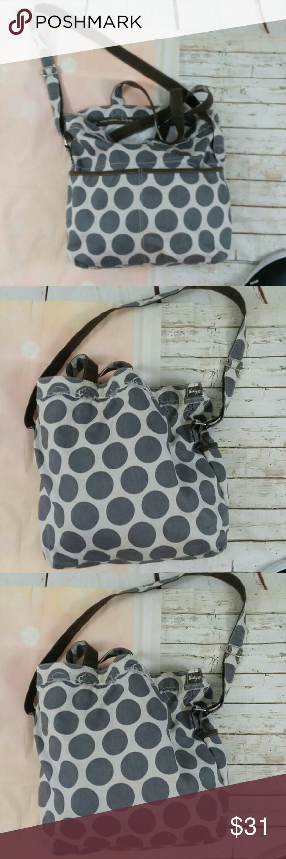 Thirty One Retro Metro Gray Mos Polka Dot Tote Bag This is the 31 brand retro Metro gray mod polka dot embroidered K bag. It is in great preowned condition and sold without stains or flaws. Measure measures 17.5 inches in length 13 in in height 7 inch bag width  and 10 inch strap drop. Thirty One Bags Hobos