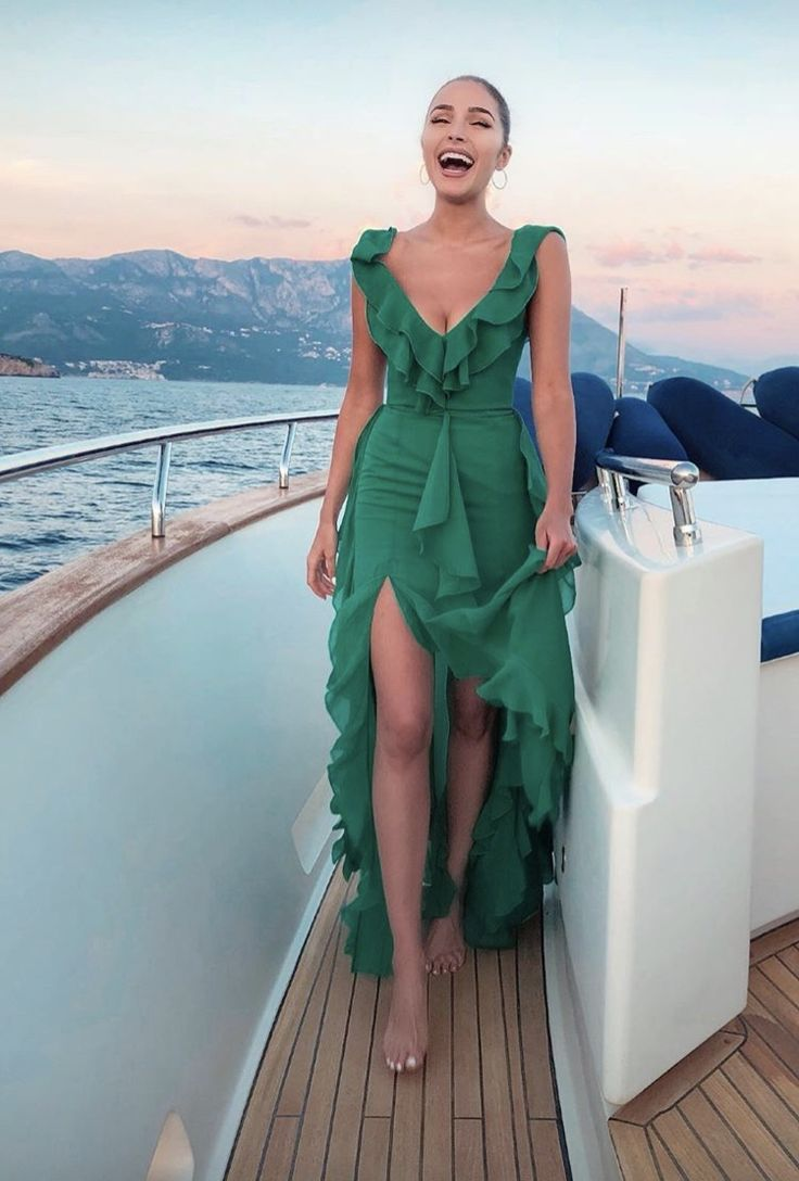 Loving this high low ruffle emerald green gown! Romantic feminine style woman in…