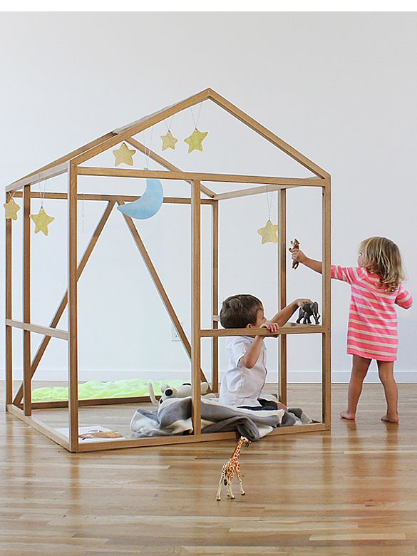 Framehouse is a wooden inside playhouse with clean and open structure for kids' imaginary play. It's created by North Forty Design.