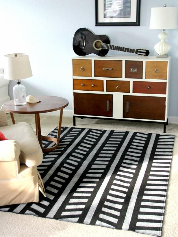 6 Easy DIY Rug Projects: How to Paint a Rug >> http://www.diynetwork.com/decorating/6-easy-diy-rugs-projects/pictures/index.html?soc=pinterest