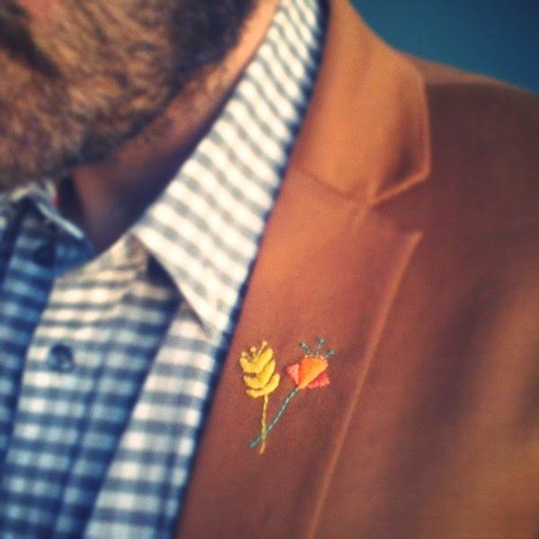 lapel embroidery- i find this so tentative and sweet....