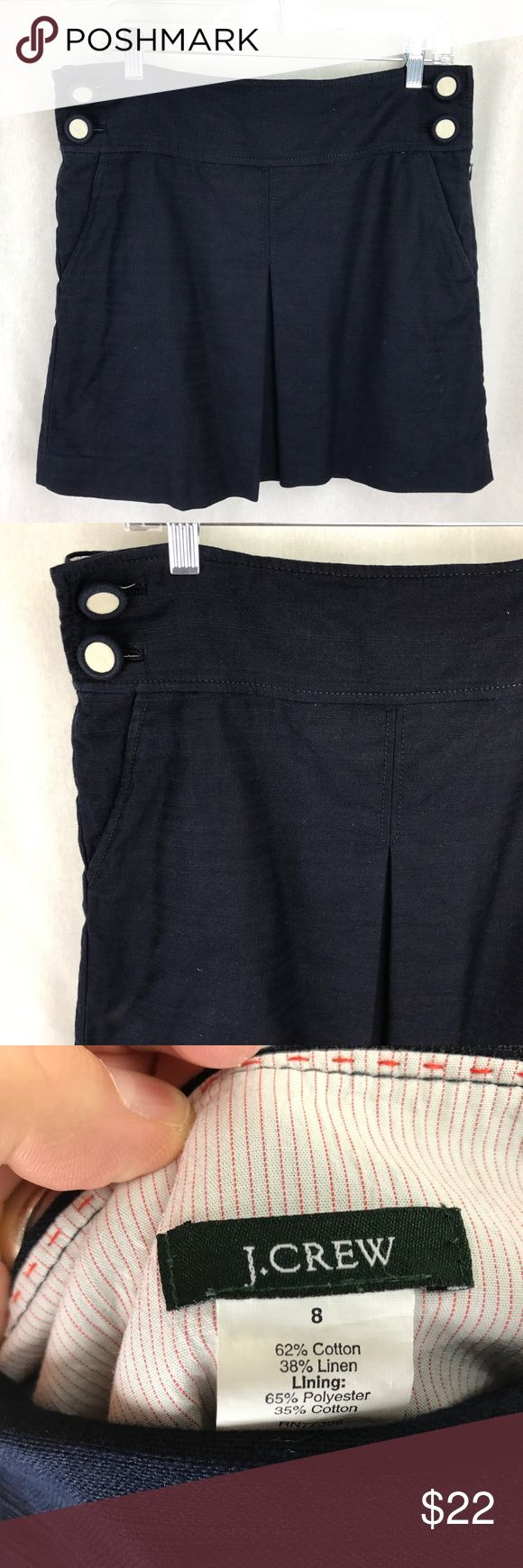 "J.Crew Women's Navy linen blend mini skirt size 8 J.Crew Women's Navy linen blend mini skirt size 8. Fully lined.  Lovely covered buttons, pockets and pleated front.  Measure approx: waist hip to hip 16 1/2"" and overall length 17 1/2"" All measurements are with item flat.  Comes from smoke free and pet free home. J. Crew Skirts Mini"