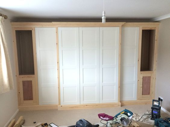 how to use standard ikea pax wardrobe frames and doors along with some extra timber framework