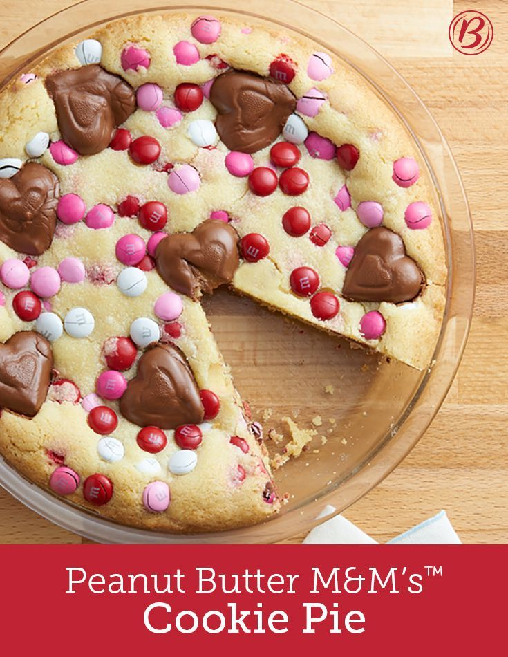 Peanut Butter M&M's™️ Cookie Pie - Win over your Valentine with this candy loaded cookie pie, made with our sugar cookie mix, M&M's and Reese's peanut butter hearts. Ready to bake in 10 minutes flat! | Betty Crocker