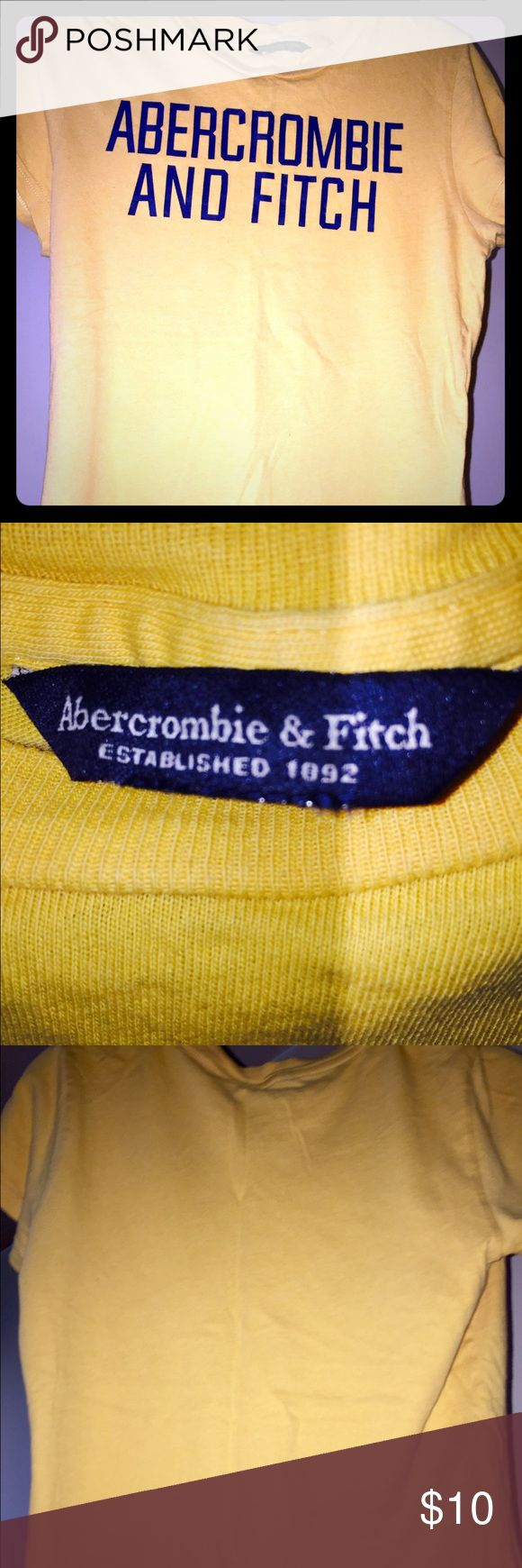 Abercrombie and Fitch Yellow T-shirt Abercrombie and Fitch yellow T-shirt size medium. Condition is Brand New Worn once. Nothing wrong with it. Great dark yellow color with blue writing. Abercrombie & Fitch Tops Tees - Short Sleeve