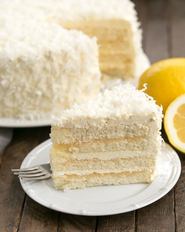 Lemon Layer Cake with Lemon Curd Filling and frosted with Lemon Swiss Meringue Buttercream! @lizzydo