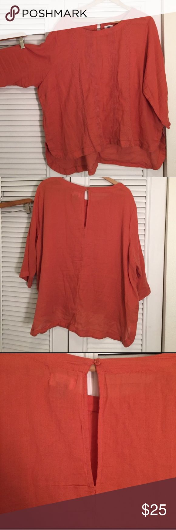 Burnt orange Blouse with Aztec design Burnt orange imprinted three-quarter length sleeve shirt shorter in front than in back, high low design with Aztec tribes embroidered designs Tops Blouses