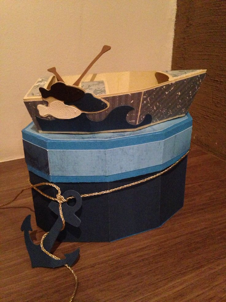 Row boat with oars and box with anchor @svgcuts