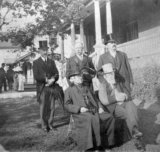 Father Lacombe, Lord Strathcona, Lieutenant Governor Bulyea, Premier Rutherford and Mr. Clarence Chipman of the Hudson's Bay Company in front of Government House, Edmonton, Alberta. Date: 1909