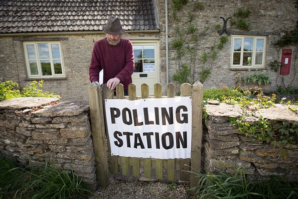 News Photo : A voter enters a polling station located in the...