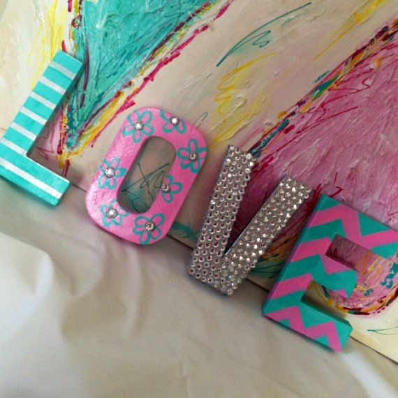 Fabulous, colorful, cheery LOVE for your room!! Hand painted letters can sit randomly on a shelf or lovingly on your wall. Pink, mint, silver
