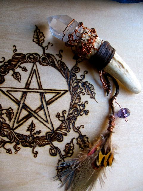 I really want that bone and crystal amulet/pendulum! So beautiful! Must have this one day! I love the pentacle carving/burning too!