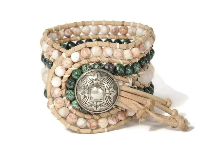 A bohemian trend bracelet !!! Semi precious stones of aventurine, agate zoesite & jasper red mat are framed by natural leather woven together with beige cotton cord. This eye catching design also features a silver metal, closure.This bohemian style bracelet upgrades your casual look.