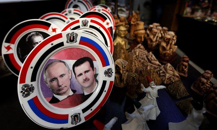 Plates bearing portraits of Bashar al-Assad and Vladimir Putin