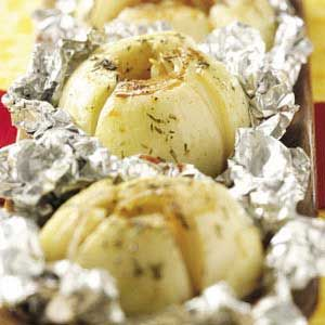 """""""These onions are so delicious, we prepare them all year long—on the grill in summer, or in an oven preheated to 350° for the same amount of time in winter. A small salad, a slice of bread…and you've got a great light meal."""" This recipe from Mary Bilke of Eagle River, Wisconsin, is sure to become a favorite!"""