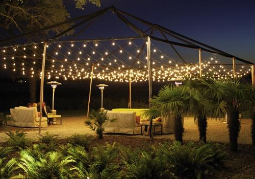 Strung lights over an outdoor area