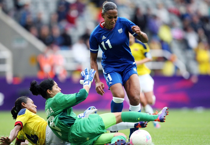 France's Marie-Laure Delie (11) vies for the ball with Colombia's Kelis Peduzine, left, and Sandra Sepulveda, center, during a group G women's soccer match at St James' Park in Newcastle, England, during the London 2012 Summer Olympics, Tuesday, July 31, 2012.