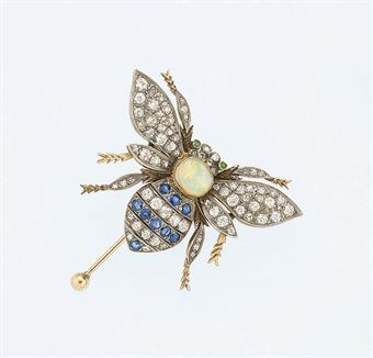 A diamond and gem brooch  Modelled as a bee with old brilliant-cut diamond and sapphire striped abdomen, opal thorax and old brilliant-cut diamond wings, legs, antennae and head, the head with emerald eyes, mounted entremblant