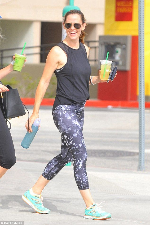 Happy-go-lucky: The 44-year-old actress looked lean in purple printed leggings and a black...