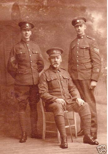 WWI Canadian CEF Machine Gun Corps MGC Photo c1916 England  Marlborough, Wiltshire, This very handsome studio portrait shows three men, perhaps family. The man on the left, wearing a medal ribbon, and wearing riding trousers, is a Sergeant of the MACHINE GUN CORPS (MGC) the man on the right is a Sergeant of the CANADIAN EXPEDITIONARY FORCE (CEF) significantly displayed are his three wound stripes. The older seated man, a Corporal, wears a General Service Cap Badge. $225 USD