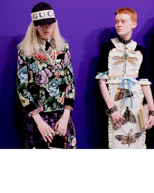Instagram media by gucci - Girls backstage wearing a flower jacket with detachable embroidered lapel, a hat with #Gucci hairband and a ruffle accented dress with jacquard detail insects. See a video of the #GucciFW17 collection through link in bio.