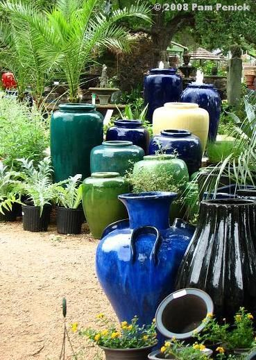 """staggered pottery with plants- tropical! would be neat to do a """"summer blues"""" theme"""