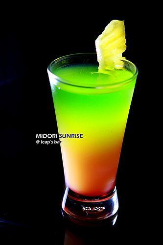 Midori Sunset -- 1oz Midori 1oz Vodka shake with ice   1/2 Grenadine 4oz of Orange Juice Midori Mix layer in a glass
