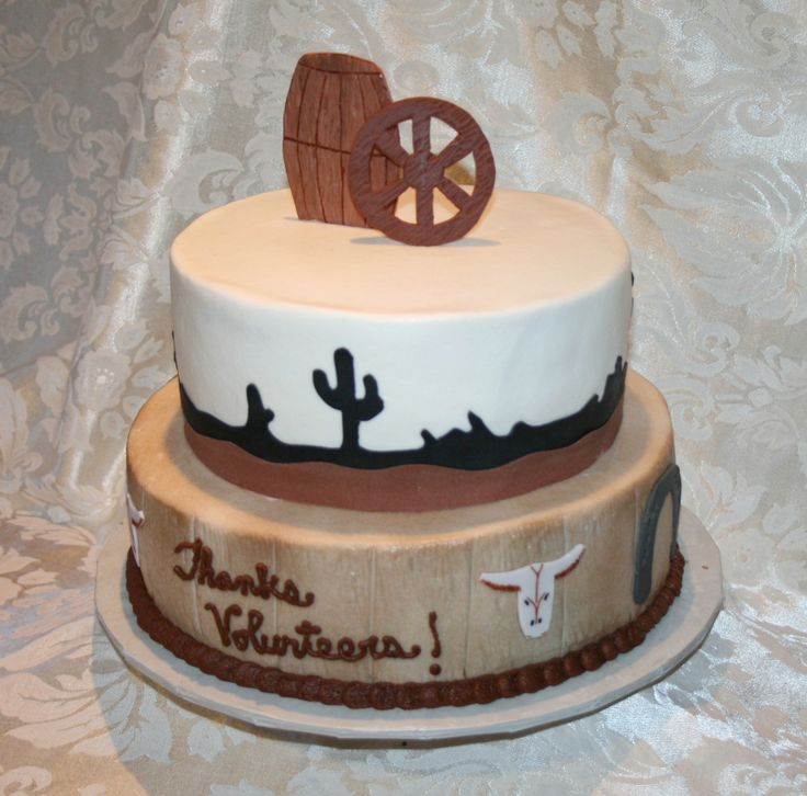 Western themed cake for American Red Cross Volunteer Appreciation event  Vanilla bean and dark chocolate cake  covered in white buttercream, bottom tier airbrushed light brown  Decorative pieces made from fondant